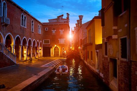 Boat on canal at famous fish market in Venice