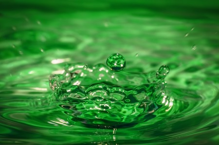 drop falling into water Stock Photo