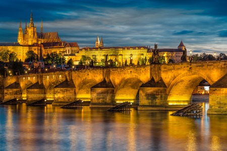 views of the Prague Castle and the Charles bridge over the Vltava Editorial