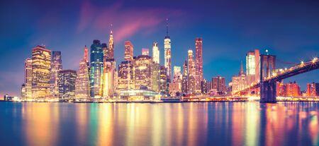 Panorama of Manhattan midtown at dusk with skyscrapers, New York City