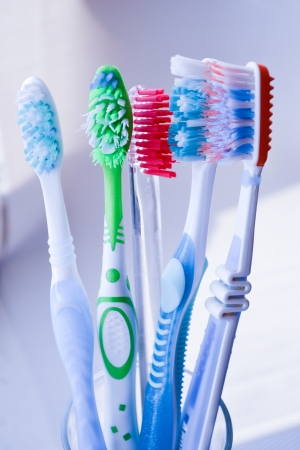 Toothbrushes in glass isolated photo