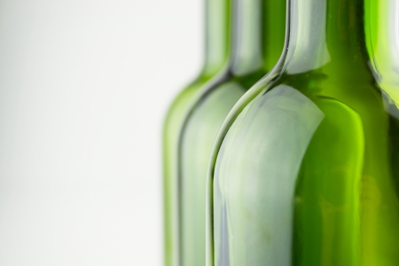 aligote:  empty green wine bottles in a row