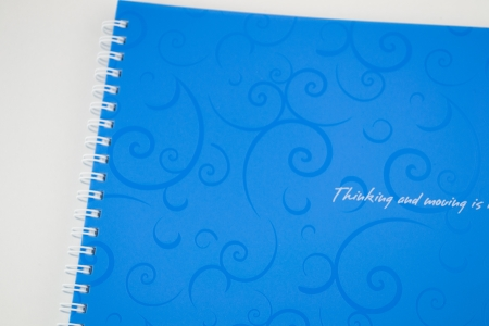 stack of ring binder book or blue notebook isolated on white  photo