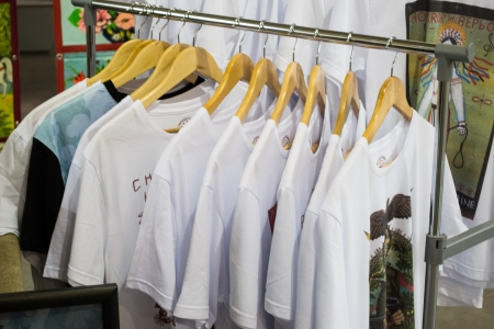 white t shirts on cloth hangers in row
