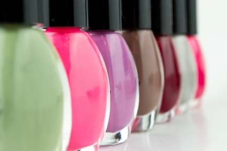 Group of bright nail polishes on white Stock Photo - 18732772