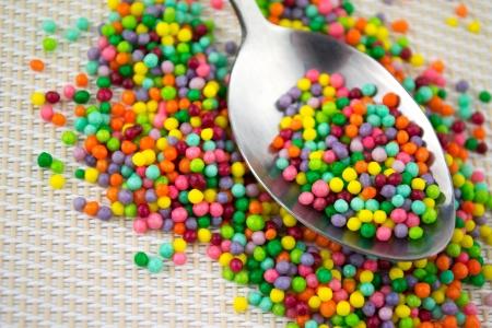 colorful sugar sprinkles in spoon  photo