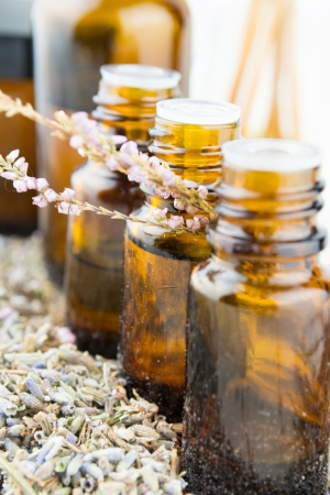 essential oil and lavender flowers photo