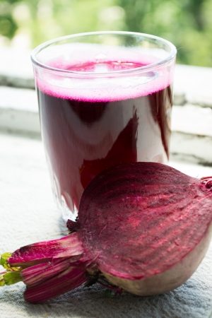carrot juice: Closeup of Fresh Red Beet Juice Stock Photo