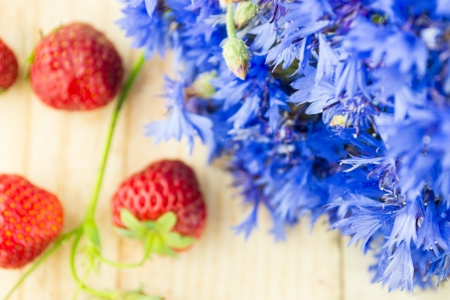 cornflowers with strawberries photo