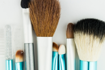 Professional makeup brushes on white photo