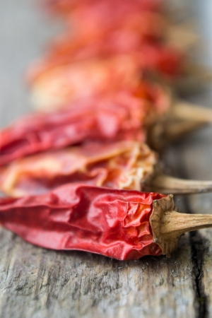 Red dry peppers on wood Stock Photo - 20592611