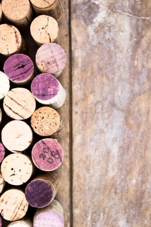 Bunch of wine corks on wooden table photo