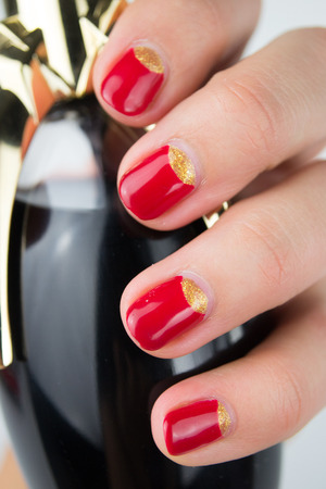 half and half: red half moon nail art manicure Stock Photo