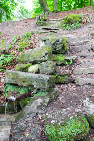 stepping: Stepping forest stones and small waterfall. Stock Photo
