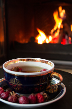 tea house: Rosehip tea in front of roaring fire in a fire place