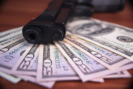 heist: Gun, drugs and money on wooden background Stock Photo