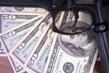 heist: Gun, drugs and money on wooden background Stock Photo