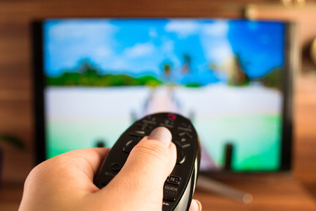 picture person: Program switching or button pressing on TV remote control