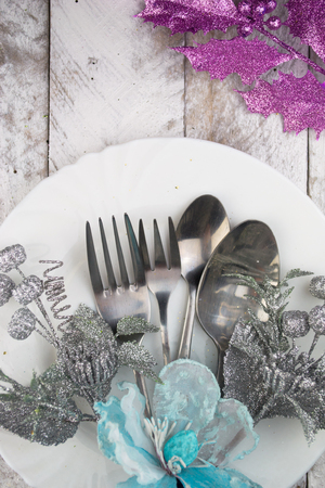 table decoration: Christmas table setting in silver and blue tone on wooden table