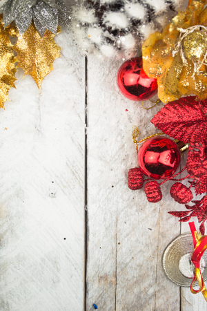silver background: Christmas decorations in red and gold tone on wooden background