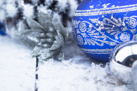 snow cone: Christmas balls and snowflake on wooden background.