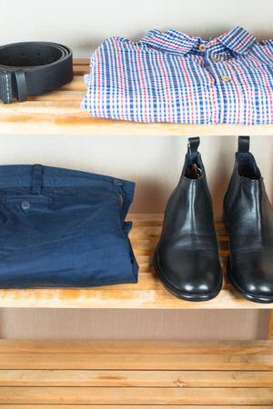 the shelf: Mens clothes on the shelf Stock Photo