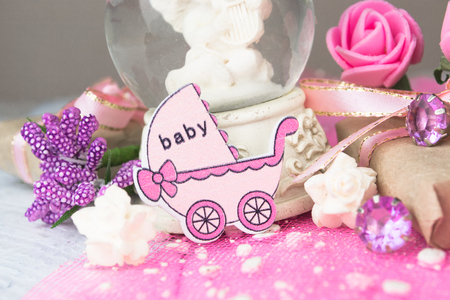 wooden figure: Pink wooden carriage figure with wrapped presents. Girl birth concept