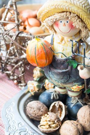 Farmer figurine with pumpkin and nuts. Halloween decoration.