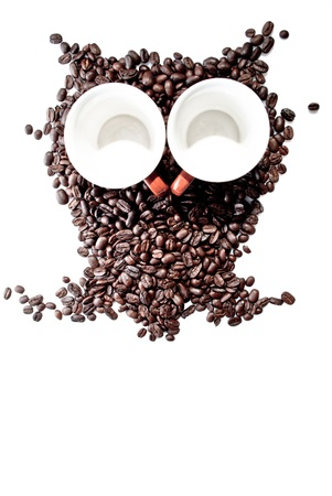 conteptual owl made with coffee beans and cups photo