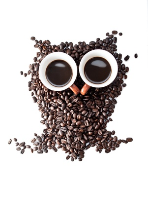 fresh morning: conteptual owl made with coffee beans and cups