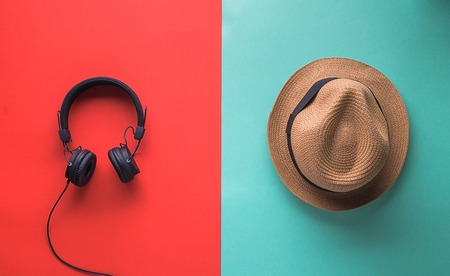 set for man on vacation black headphone  for music and straw hat