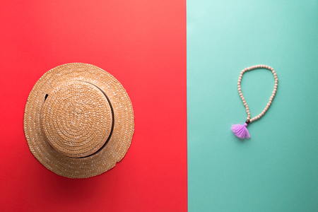 retro set of vacation on red and blue background with straw hat and beans for meditation