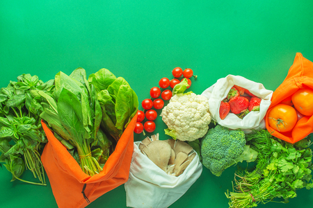 Mixed Vegetables  without plastic backs with copy space on green background 版權商用圖片