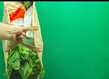 Mixed Vegetables  without plastic backs with copy space on green background Фото со стока
