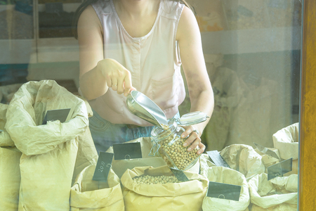 woman is bying products in zero waste shop