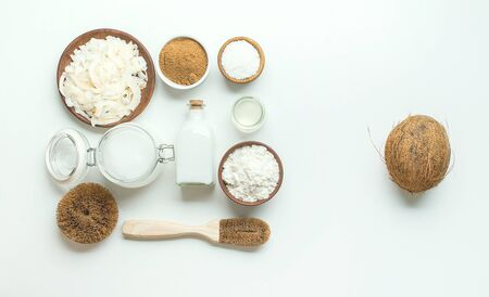 variety of products made from coconut on white background with copy space