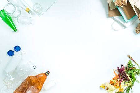 concept of recycling differnt materials glass, paper, food, plastic on white background with coppy space