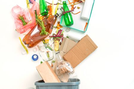 concept of recycling different materials glass, paper, food, plastic on white background with copy space. All garbage goes in one bin