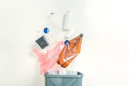 concept of recycling plastic on white background with coppy space. selected clean plastic in the basket