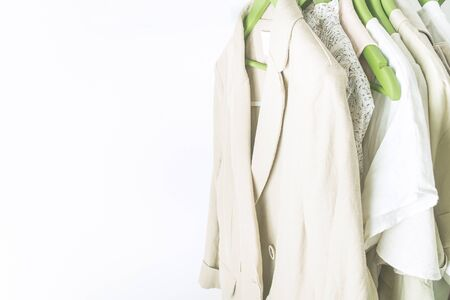 summer wardrobe with linnen clothes on green hangers Stok Fotoğraf