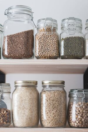 shelves with glass jars filled with groceries. concept of zero waste home and lifestyle