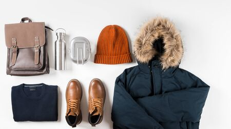 winter men's base wardrobe on white background with copy space