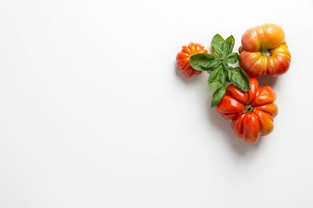 organic red tomatoes on white background