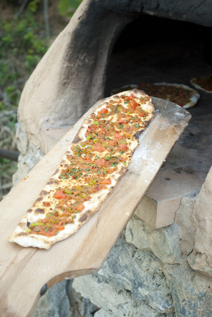 tomatto: Turkish Pizza  Lahmacun on furnace Stock Photo