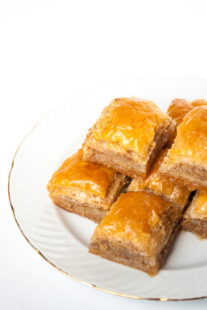 baklawa: Sweet Baklava on plate isolated on white background. Turkish traditional delight