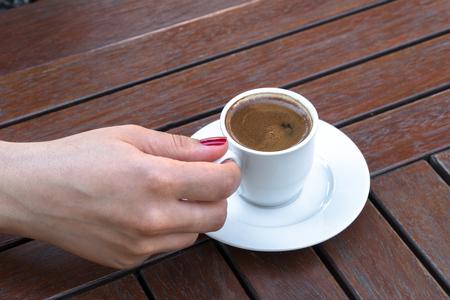A Woman Holding a Cup of Turkish Coffee 版權商用圖片