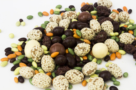 mixed nuts: Mixed colorful candies on a white background.