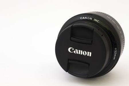50mm: BRNO, CZECH REPUBLIC - APRIL 4, 2015: Very popular Canon EF 50mm f1.8 II lens on a white background.