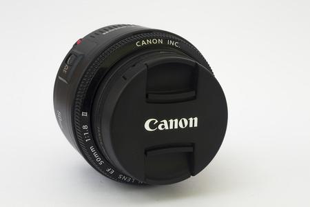 autofocus: BRNO, CZECH REPUBLIC - APRIL 4, 2015: Very popular Canon EF 50mm f1.8 II lens on a white background.