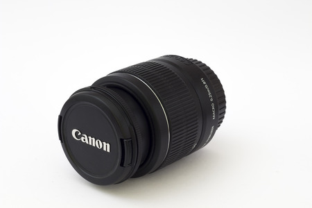 50mm: BRNO, CZECH REPUBLIC - APRIL 7, 2015: Very popular Canon EF-S 18 - 55 IS II lens on a white background. Editorial